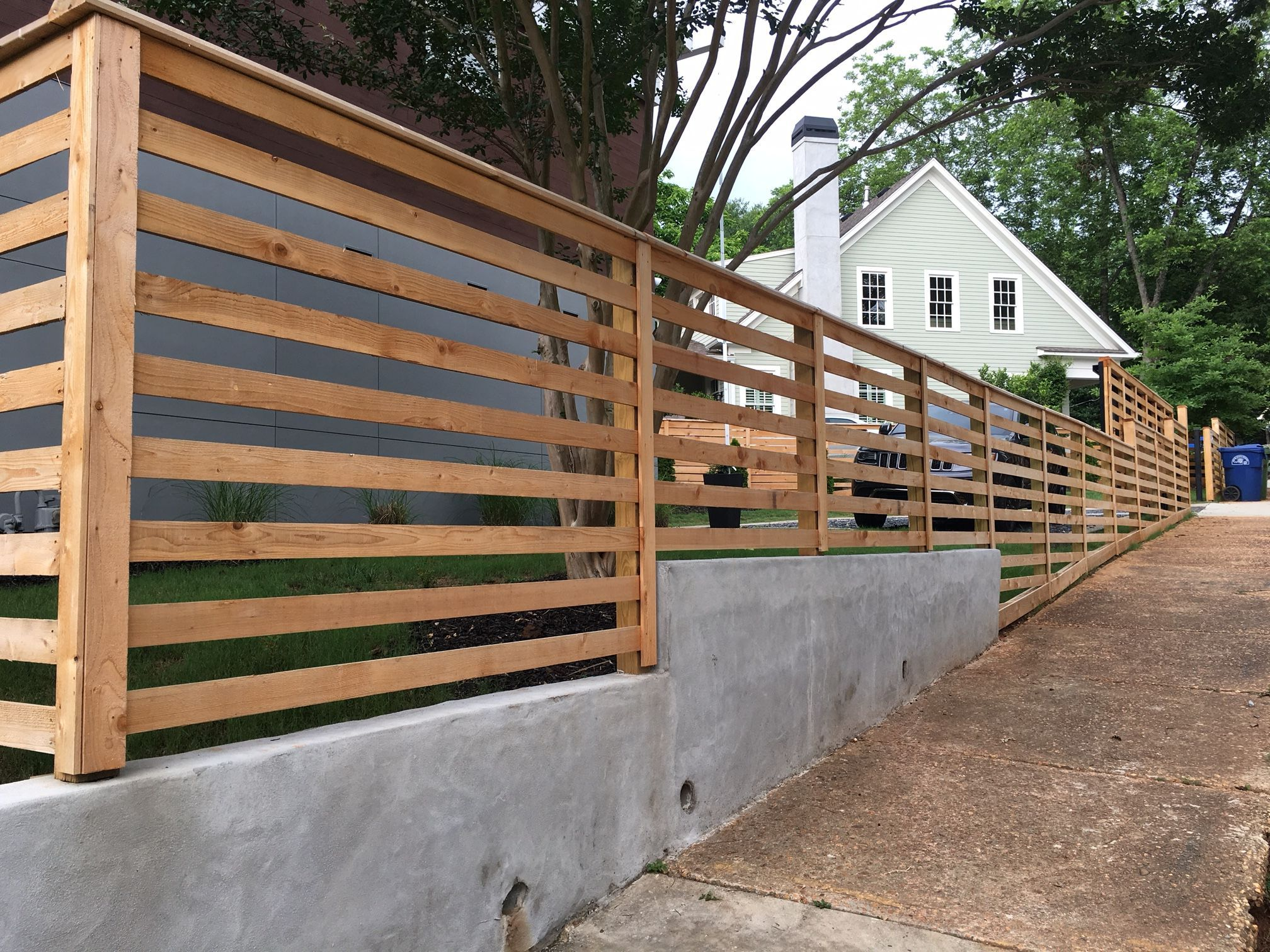 Custom Cedar Board Fencing Mounted on Concrete Wall